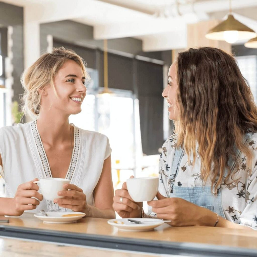 Friends talking over a coffee