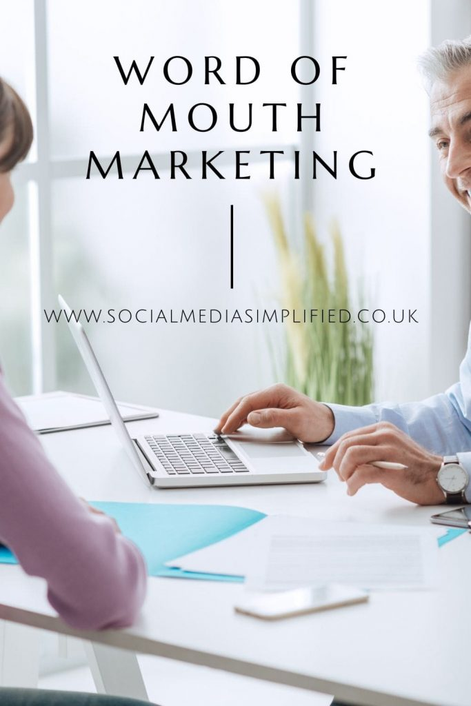 Two people talking over the desk displaying word of mouth marketing visually