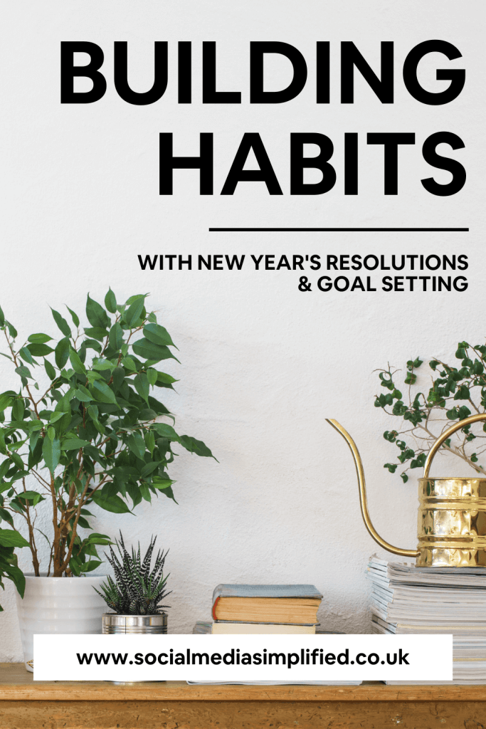 Books on a desk to encourage goal setting and habit building