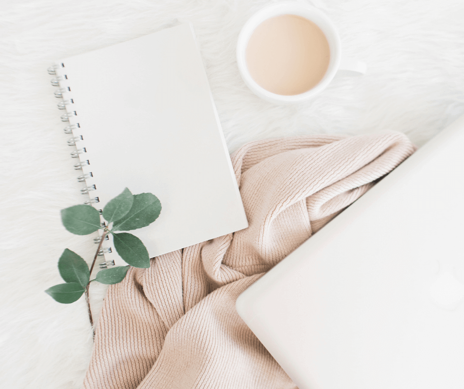 Journal and cup of tea on the table