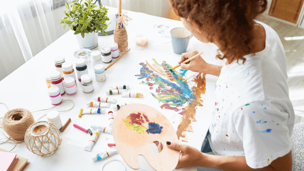 Woman using painting as her creative outlet