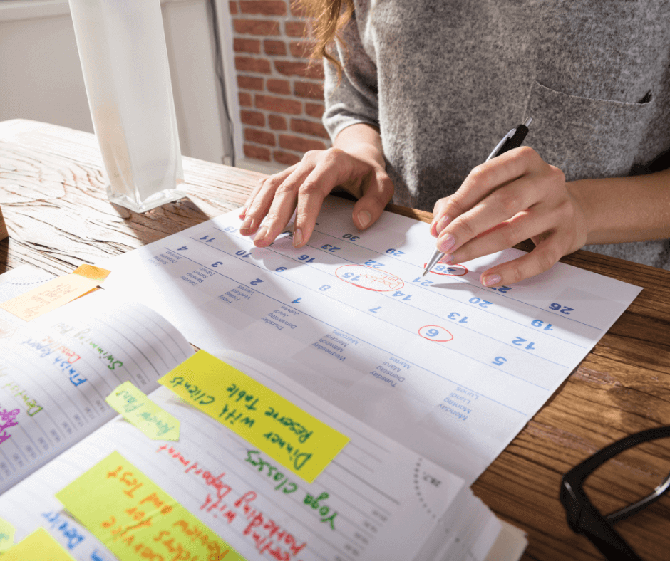 Woman planning her month on a calendar